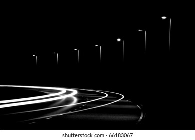 Light trails from cars and streetlights in the night. Black and White version