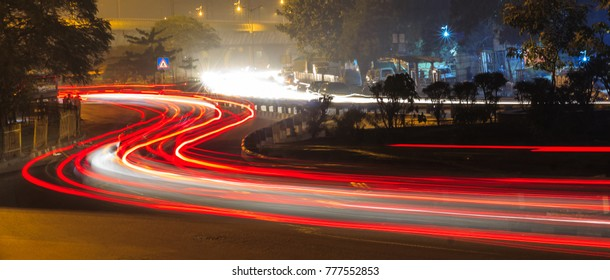 Light trails of cityscape in twilight at night, New Delhi, India