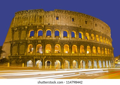 Light trails at Colosseum in twilight, Rome Italy