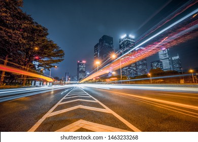 light trails in the downtown district, china