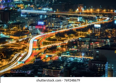 Light trails during rush hour on Philadelphia downtown highways
