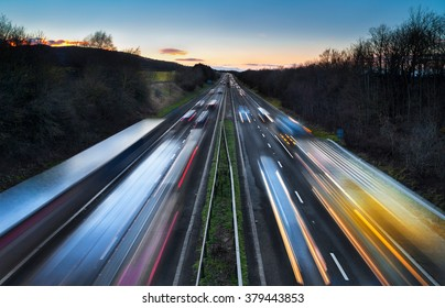 Light Trails of Fast Moving Cars on Busy Motorway at Dusk