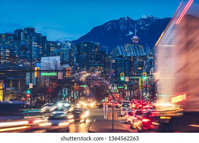 light trails go out of the downtown vancouver at night.
