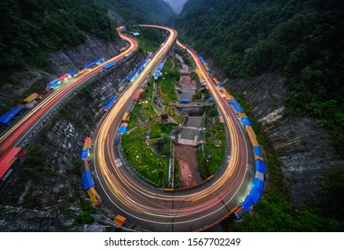 Light Trails at Kelok 9 Bridge, is a stretch of winding road 30km east of Payakumbuh, West Sumatra, Indonesia. Originally built by the then Dutch colonials in 1908-1914, it was inaugurated in 2013.