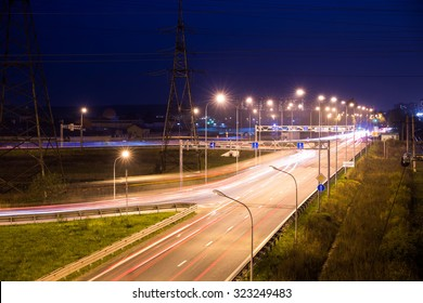 Light trails at night on the highway