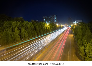 light trails on city road ,busy urban night view