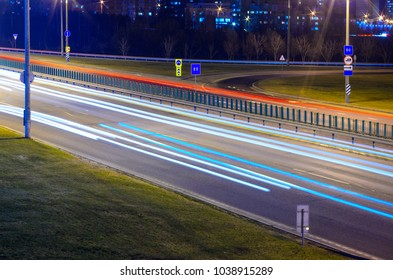 Light trails on highway at night, long exposure abstract urban background