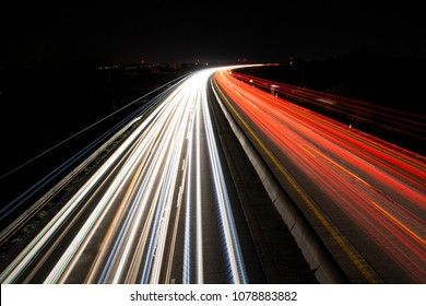 light trails on highway at night, long exposure photo