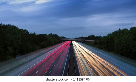 Light trails on the M6 motorway  with last light in the sky, England