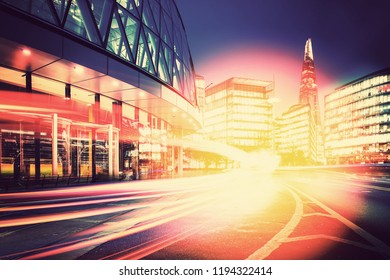Light trails on the modern building background with vintage color
