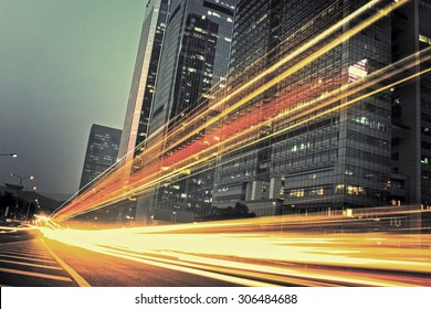 the light trails on the modern building background in city