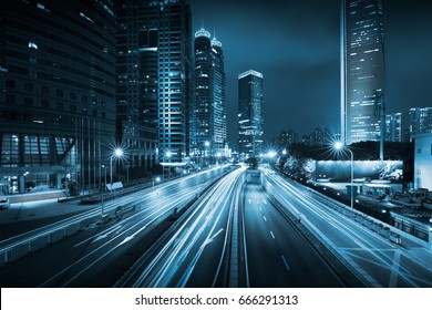 Light trails on the modern building background in Shanghai, China