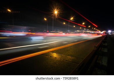the light trails on the modern building background in moscow russia.