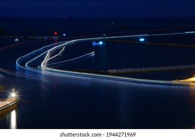Light trails produced by fishing boats traveling at night