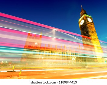 Light trails of Red Bus in front of Big Ben and Westminster Palace.