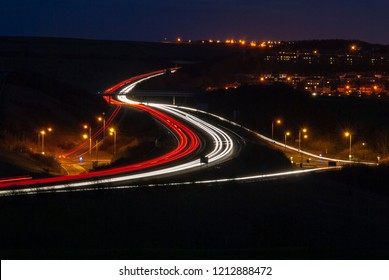 Light trails through a junction after dusk