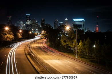 Light trails toward downtown Houston, Texas