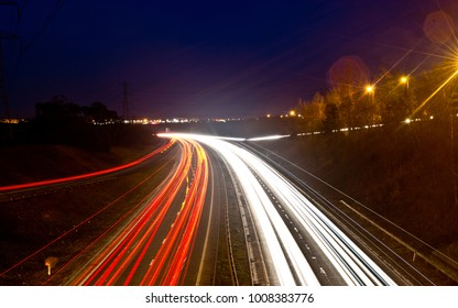 Light trails from the traffic  below on a busy road. long exposure