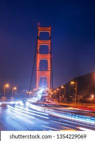 Light trails of traffic passing under the Golden Gate bridge. San Francisco, California