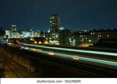 Light trails from a train arriving at London Victoria railway station at night