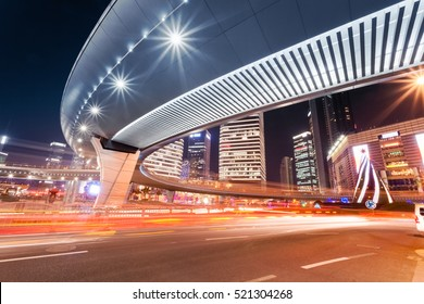 light trails under pedestrian bridge of the downtown in shanghai