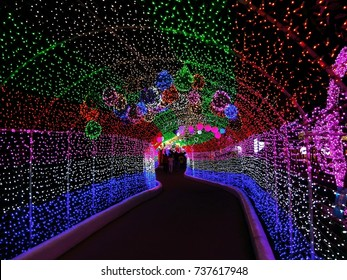 Light tunnel, Christmas decoration, the tunnel of rainbow LED lights, Rainbow color lighting on walkway stairs, Christmas celebration