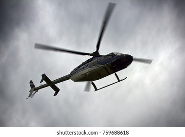 Light Utility Helicopter. Helicopter for transportation of individuals or medical on background of cloudy sky