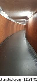 light in walkway underground tunnel, walkway in subway blurry background