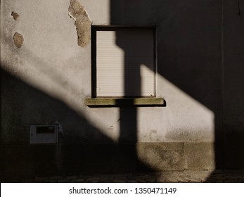 Light in a wall with closed window.