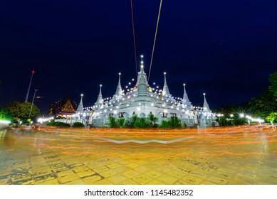 light waving rite around the white pagoda of Wat Asokkaram / White pagoda with wave lighting of candle