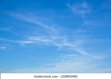 Light white cirrus clouds in the blue sky on a summer day