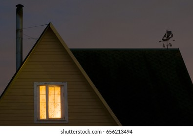 Light in the window of the house opposite
