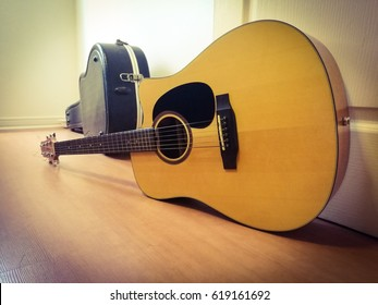 Light from the window make this guitar look very nice with shadow.