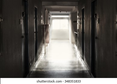 The light from the window of an old hotel corridor.
