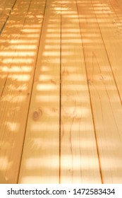 Light Wood boards are arranged in the roll with sunlight shine through battens for classic background.