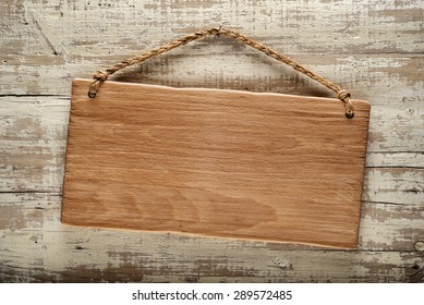 light wood rustic signboard on aged wooden wall, vintage image