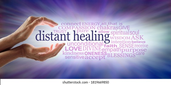 Light worker sending high frequency distant healing word  cloud concept - cupped hands with white light between and a DISTANT HEALING word cloud against an outward streaming blue energy field