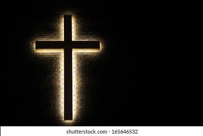 Light of the World. Cross on a brick wall with copy space.