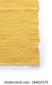 light yellow fabric on white background in sun light