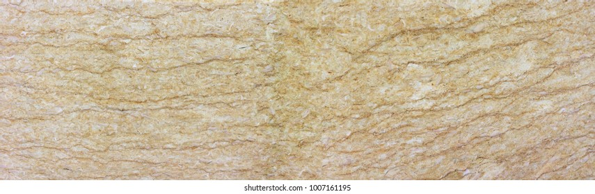 Light yellow limestone banner with darker veins