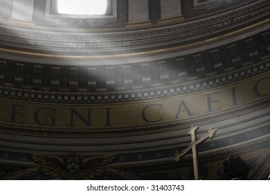 Lightbeams falling through the windows of the dome of Saint Peter's Basilica on the cross of the altar, Vatican, Rome, Italy, Europe