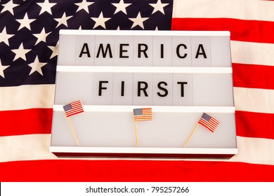 Lightbox with letters - AMERICA FIRST - on an american national flag