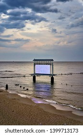 Lightbox in the middle of the baltic sea. Beach on the Baltic Sea island of Usedom. Germany