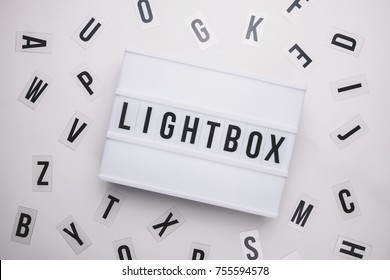 Lightbox on a table with typography letters