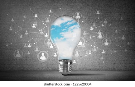 Lightbulb with blue skyscape and clouds inside placed against sketched social network system on wall. 3D rendering.
