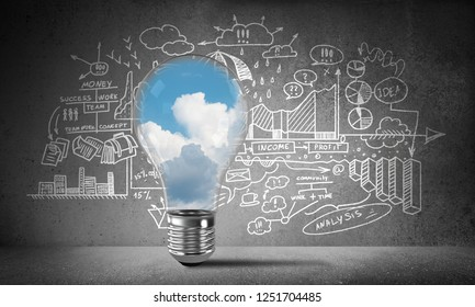 Lightbulb with cloudly skyscape inside placed against sketched business-analytical information on wall. 3D rendering.