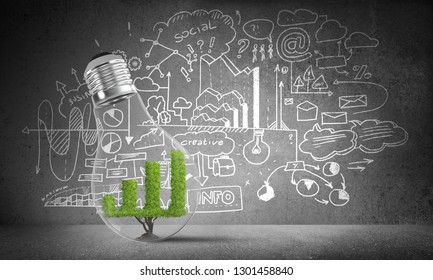 Lightbulb with green growing graph inside placed against sketched business-analytical information on grey wall. 3D rendering.