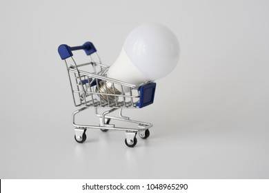 Lightbulb on shopping cart. Smart Idea concept