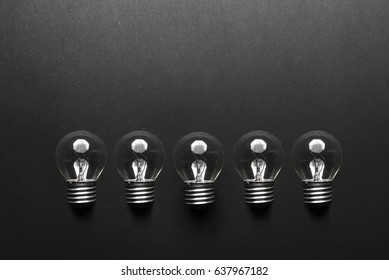 Lightbulb on yellow background.