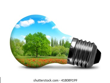 Lightbulb with a trees in poppy field.. Environment or energy concept background.